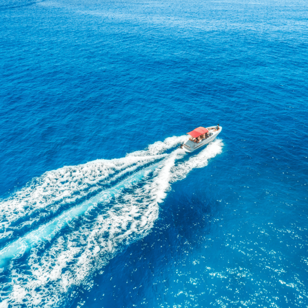 speedboat moving fast on a crystal blue ocean