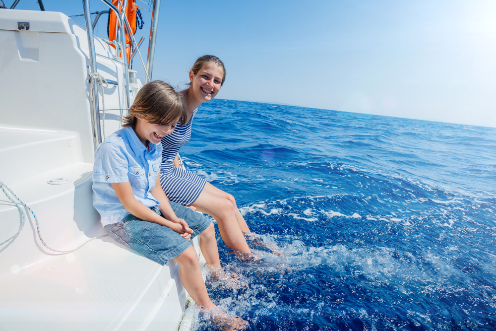 kids on a private boat at sea